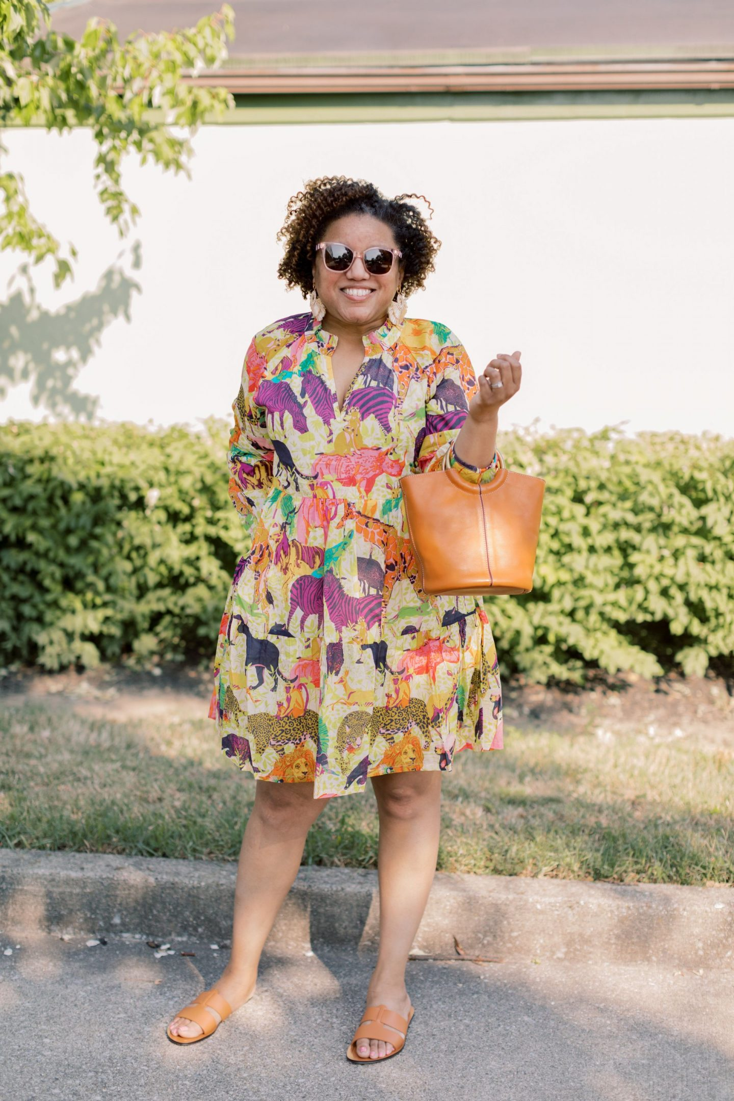 Cute effortless dresses featured by top KW fashion blogger, Really Rynetta: image of a woman wearing a JCrew safari print dress