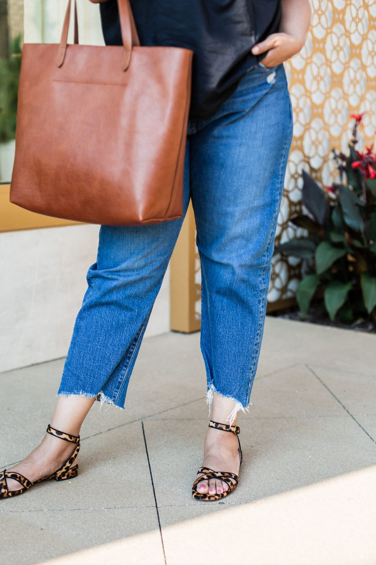 Zappos Womens Shoes by popular Kentucky fashion blog, Really Rynetta: image of a woman wearing a Zappos black flutter sleeve top, Zappos jeans, and Zappos leopard print block heel sandals.