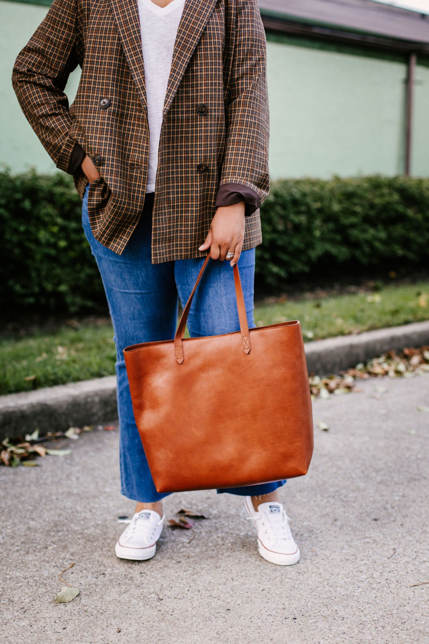 Madewell Blazer by popular Kentucky fashion blog, Really Rynetta: image of a woman wearing a Madewell Caldwell Double-Breasted Blazer in Mandell Plaid, Madewell Whisper Cotton V-Neck Pocket Tee, Madewell Cali High Waist Demi Boot Jeans, Nordstrom Chuck Taylor® Shoreline Sneaker CONVERSE, and holding a Madewell The Transport Tote.