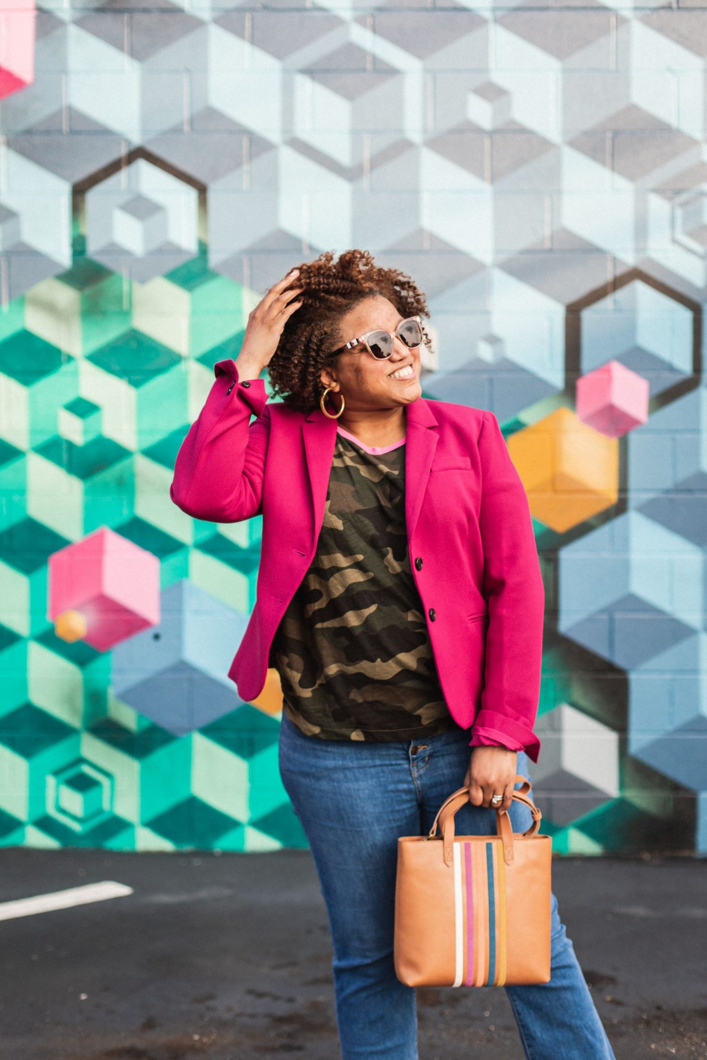 Fall Clothing by popular Kentucky fashion blog, Really Rynetta: image of a woman sitting on a curb and wearing a Nordstrom pink blazer, Nordstrom camouflage shirt, white Converse sneakers, Nordstrom crop jeans, and Nordstrom leather tote.