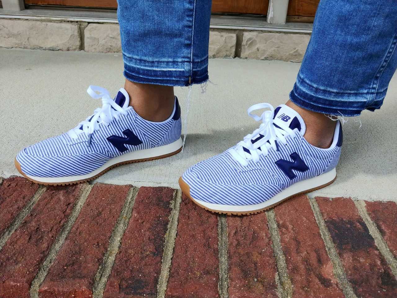 New Balance sneakers by popular Kentucky fashion blog, Really Rynetta: image of a woman wearing a pair of jeans and a pair of New Balance X J. Crew Comp 100 Sneakers in Stripe.