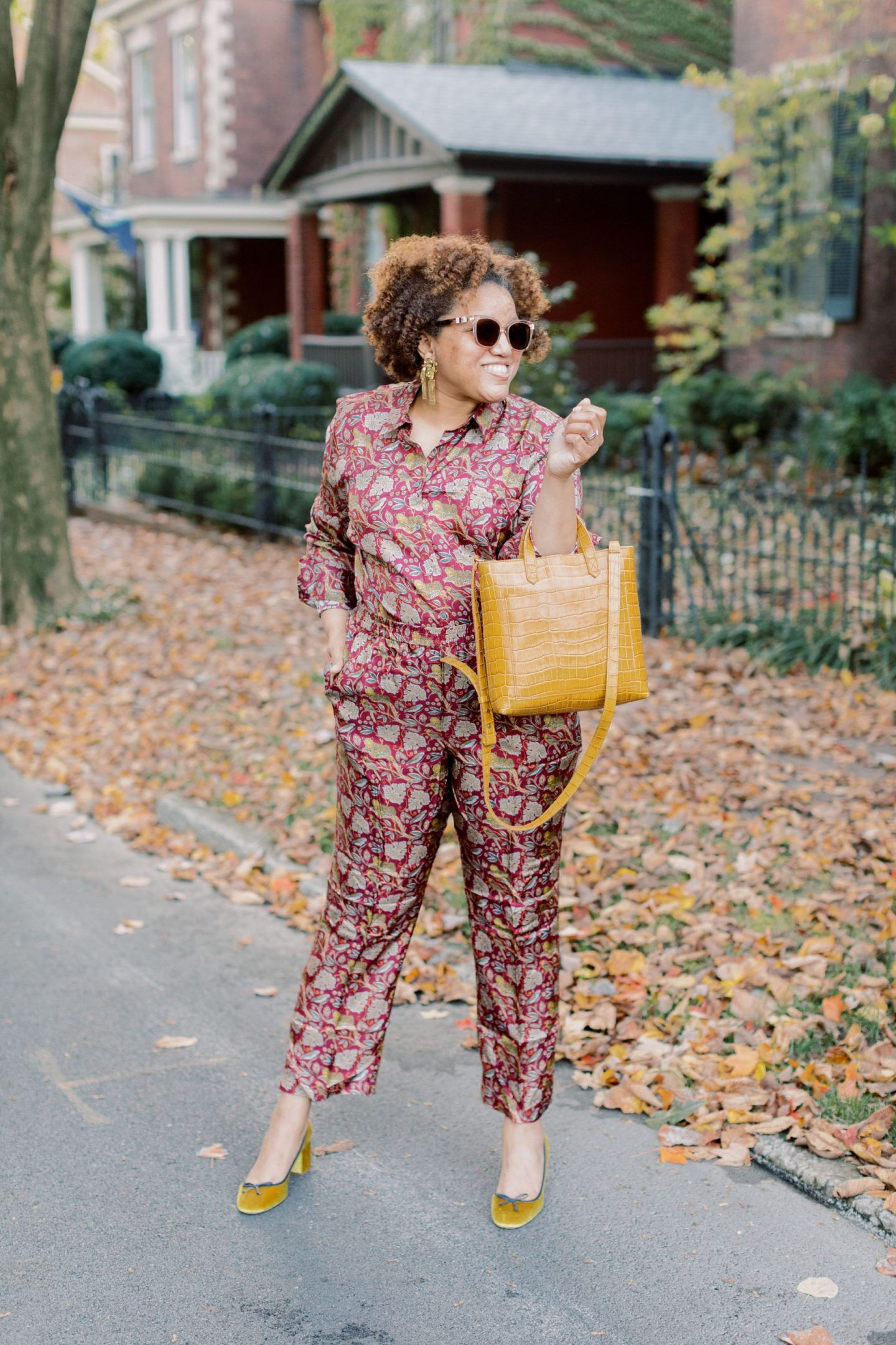Fall Prints by popular Kentucky fashion blog, Really Rynetta: image of a woman wearing a J.Crew Collection silk twill shirt in jungle cat print, J.Crew Pull-on silk-twill pant in jungle cat print, Nordstrom Marc Fischer LTD Yulunda Pump, Kendra Scott Holland Statement Earrings in Vintage Gold, and holding a Madewell The Small Transport Crossbody bag.