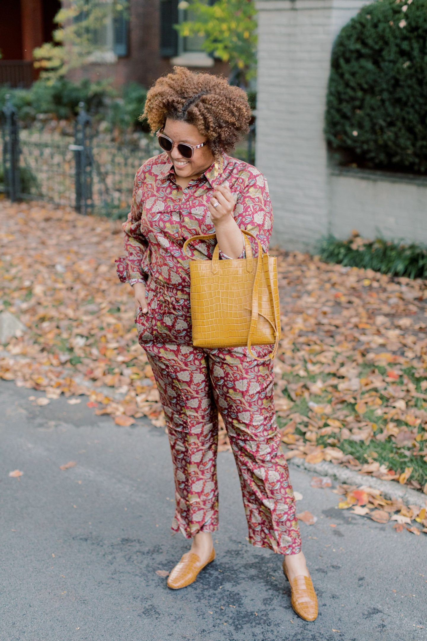 Fall Prints by popular Kentucky fashion blog, Really Rynetta: image of a woman wearing a J.Crew Collection silk twill shirt in jungle cat print, J.Crew Pull-on silk-twill pant in jungle cat print, J.Crew Smoking slippers, Kendra Scott Holland Statement Earrings in Vintage Gold, and holding a Madewell The Small Transport Crossbody bag.