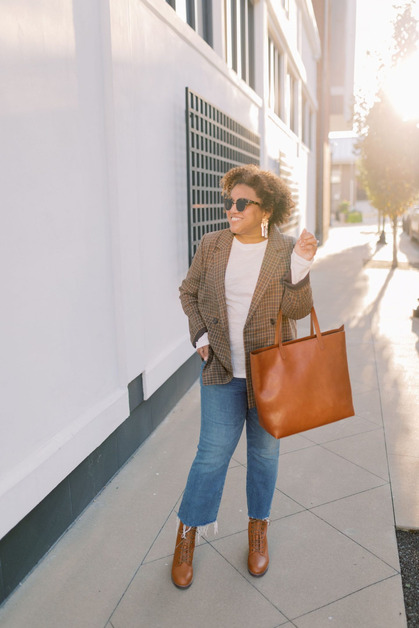 Fall Clothing by popular Kentucky fashion blog, Really Rynetta: image of a woman standing outside and wearing a Madewell Caldwell Double-Breasted Blazer in Mandell Plaid, Madewell Whisper Cotton Rib-Crewneck Long-Sleeve Tee MEDIA, Madewell Cali Demi-Boot Jeans in Fleetwood Wash, Madewell The Patti Lace-Up Boot, Madewell The Zip-Top Transport Carryall, and Kendra Scott Holland Statement Earrings In Vintage Gold.