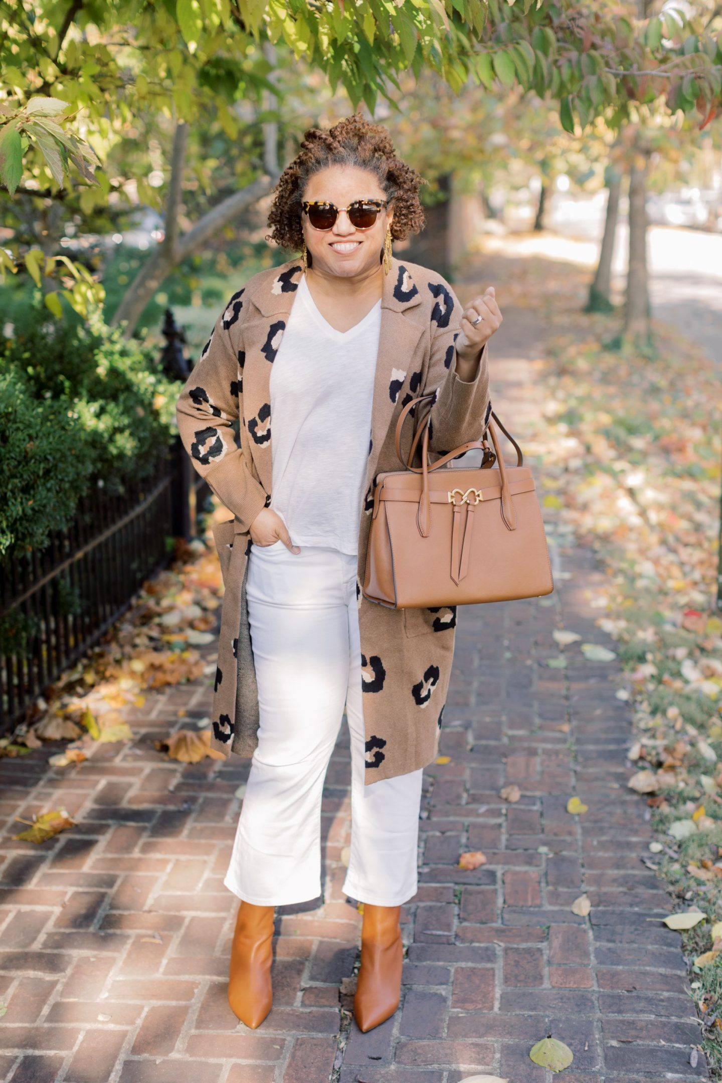 Fall Sweaters by popular Kentucky fashion blog, Really Rynetta: image of a woman wearing a J. Crew Ella open-front long sweater-blazer in leopard, Madewell Cali Demi-Boot Jeans in Pure White, Kendra Scott Holland Statement Earrings In Vintage Gold, J. Crew Pointed-toe Sadie boots in leather, and holding a Kate Spade bag.