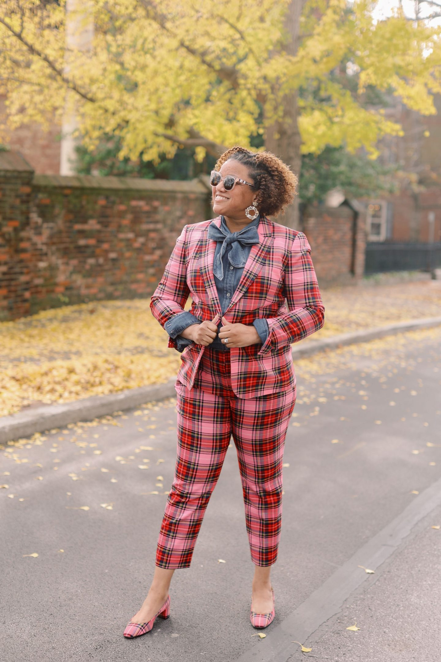 Pink Clothing by popular Kentucky fashion blog, Really Rynetta: image of a woman wearing a J. Crew pink Stewart tartan suit with a denim button up shirt.