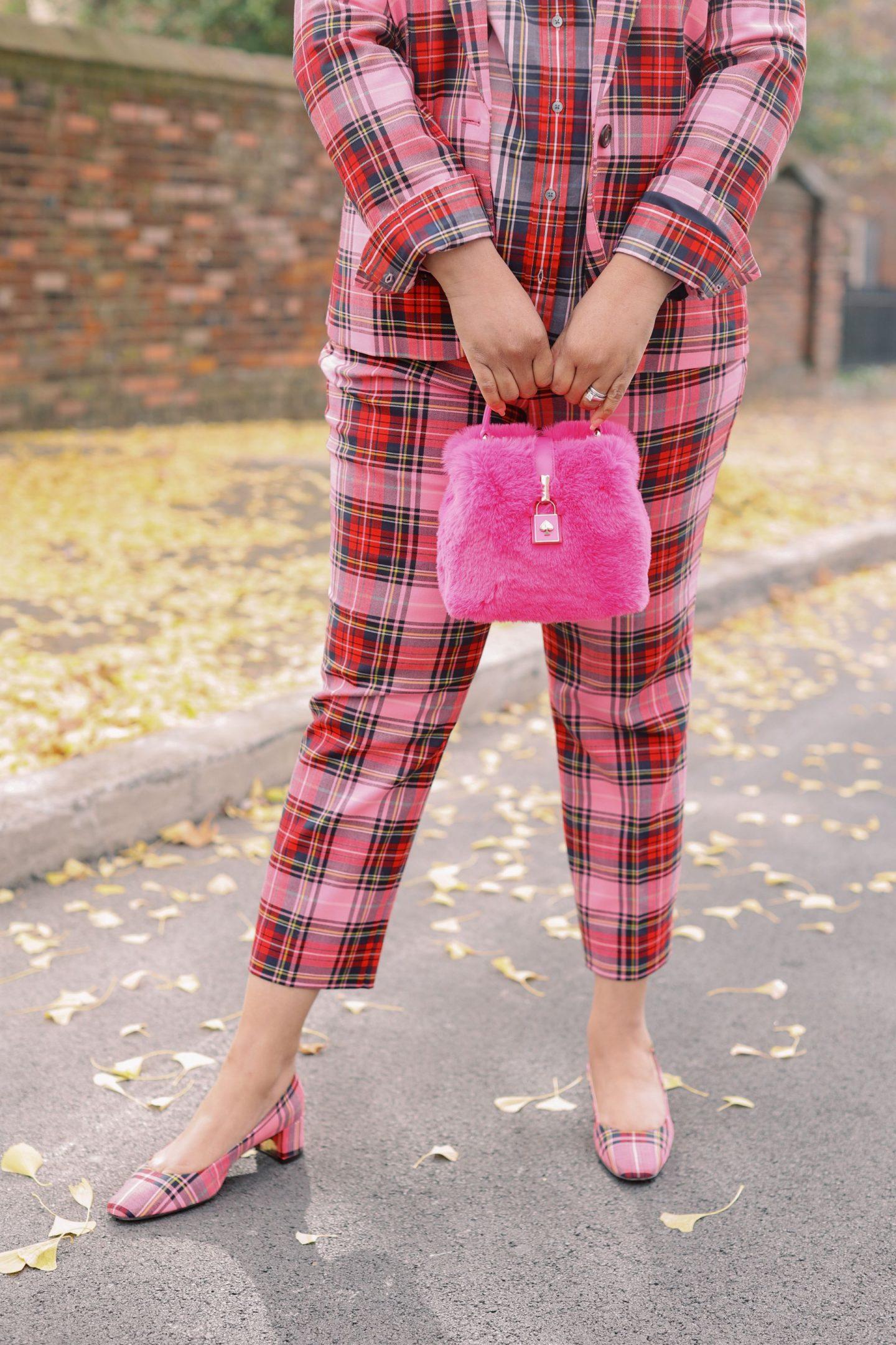Pink Clothing by popular Kentucky fashion blog, Really Rynetta: image of a woman wearing a J. Crew pink Stewart tartan suit and a tartan button up shirt.