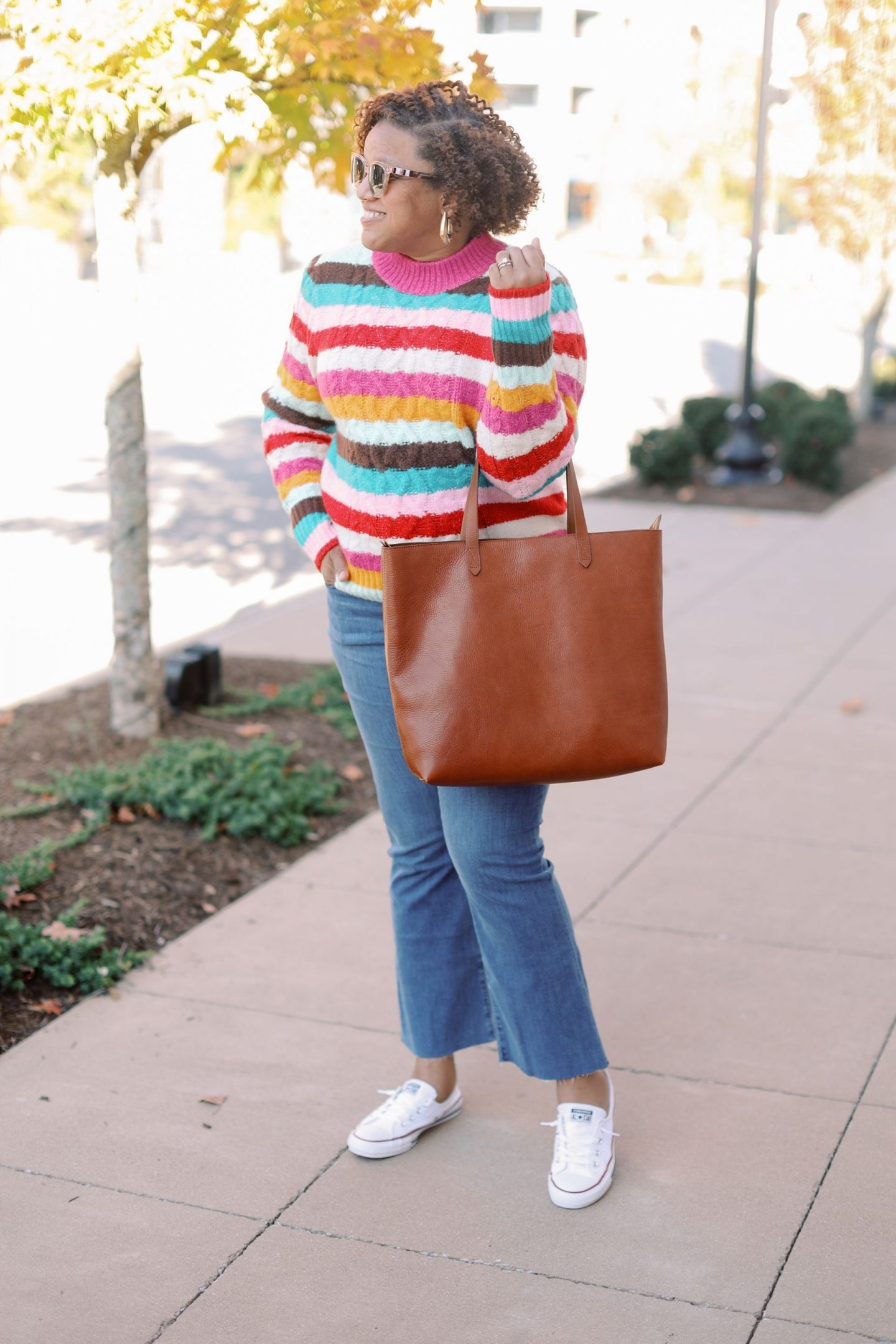 Fall Clothing by popular Kentucky fashion blog, Really Rynetta: image of a woman wearing a Nordstrom x Atlantic-Pacific Cable Knit Sweater HALOGEN®, Nordstrom Slim Demi-Boot Jeans MADEWELL, Nordstrom Chuck Taylor® Shoreline Sneaker CONVERSE, Nordstrom Zip Top Transport Leather Tote MADEWELL, and Nordstrom Kaia Huggie Hoop Earrings KENDRA SCOTT.