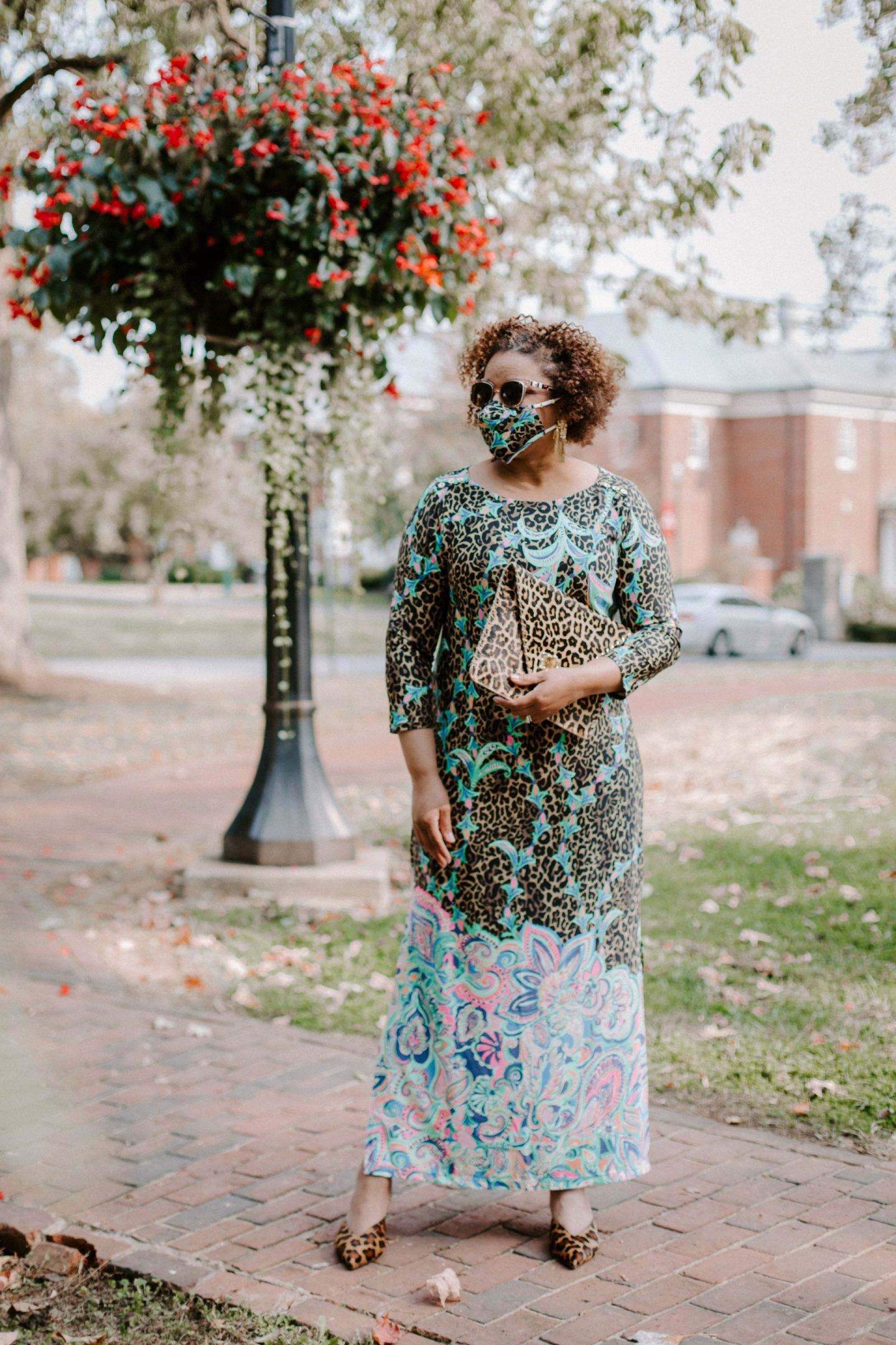 Lilly Pulitzer Dress by popular Kentucky fashion blog, Really Rynetta: image of a woman wearing a Lilly Pulitzer UPF 50+ ChillyLilly Seraline Maxi Dress, leopard print heels, Kendra Scott Holland Statement Earrings and holding a Kate Spade leopard print clutch.