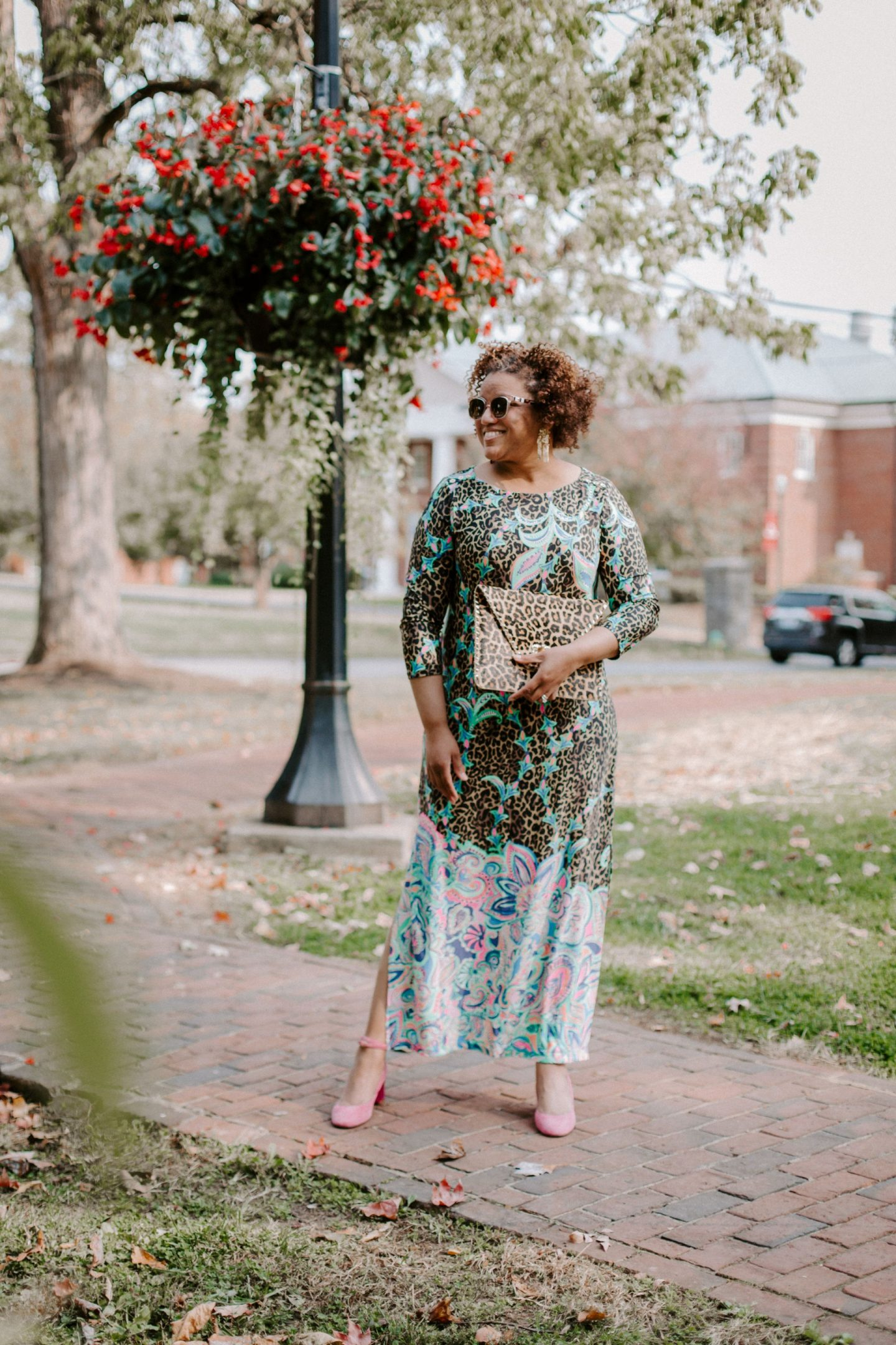 Lilly Pulitzer Dress by popular Kentucky fashion blog, Really Rynetta: image of a woman wearing a Lilly Pulitzer UPF 50+ ChillyLilly Seraline Maxi Dress, pink suede block heel shoes, Kendra Scott Holland Statement Earrings and holding a Kate Spade leopard print clutch.