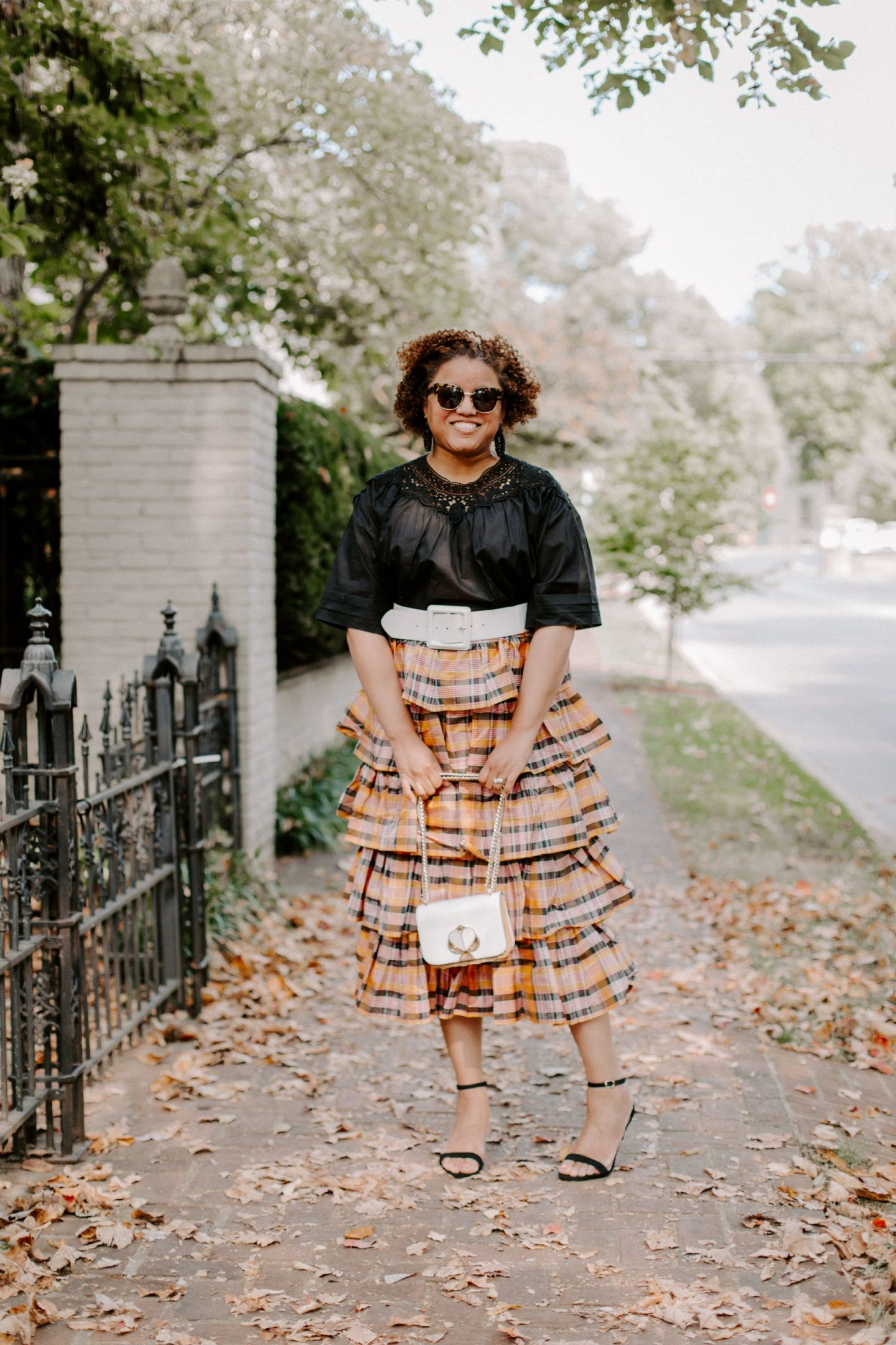 Fall Clothing by popular Kentucky fashion blog, Really Rynetta: image of a woman standing outside on a sidewalk and wearing a J. Crew Ruffle maxi skirt, J. Crew Crochet top in cotton voile, black bead earrings, x Atlantic-Pacific Covered Buckle Stretch Belt HALOGEN, Kate Spade sandals, and holding a Kate Spade bag.