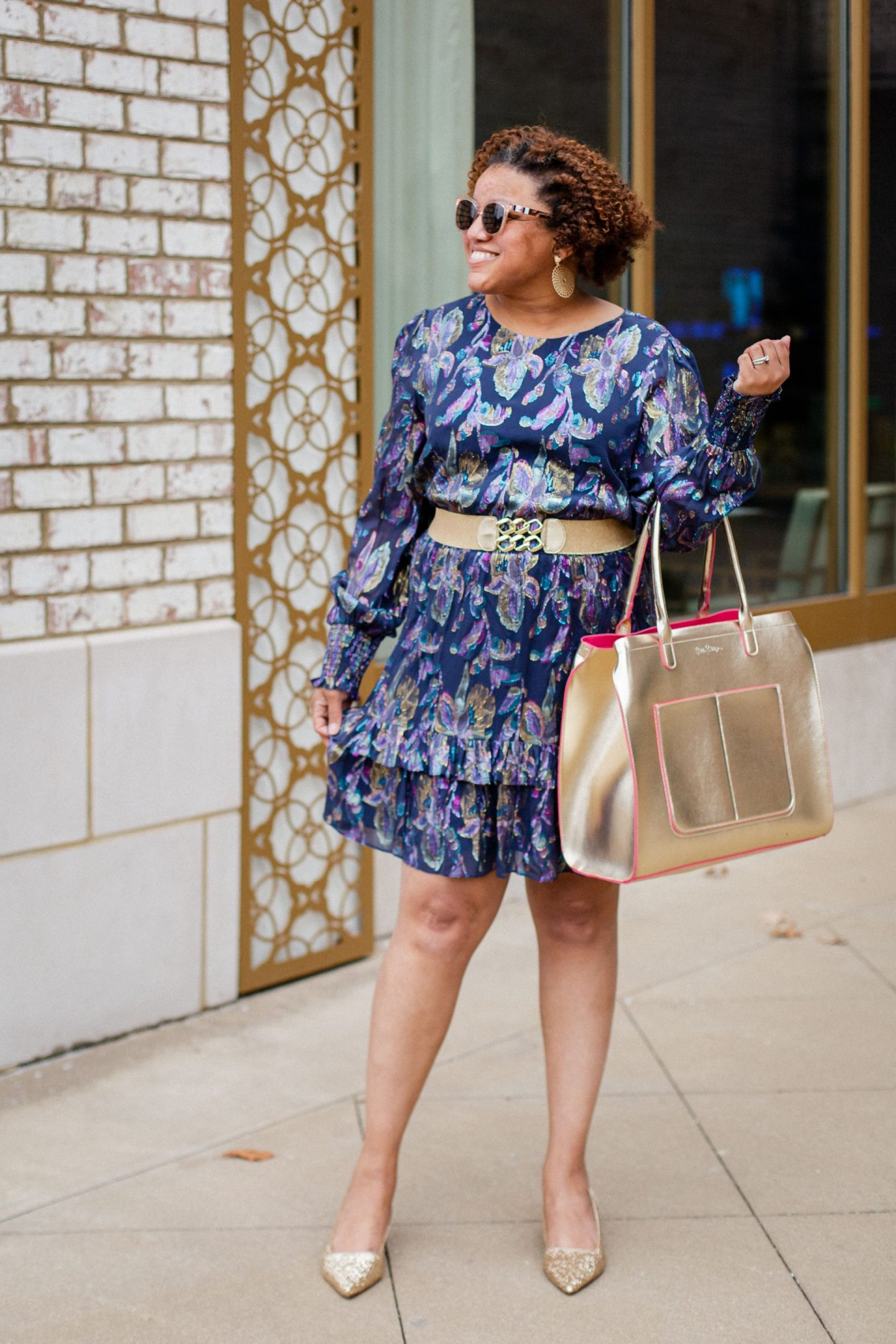 Lilly Pulitzer Sale by popular Kentucky fashion blog, Really Rynetta: image of a woman wearing a Lilly pulitzer ruffle hem dress, gold glitter heels and holding a gold Lilly Pulitzer tote bag.