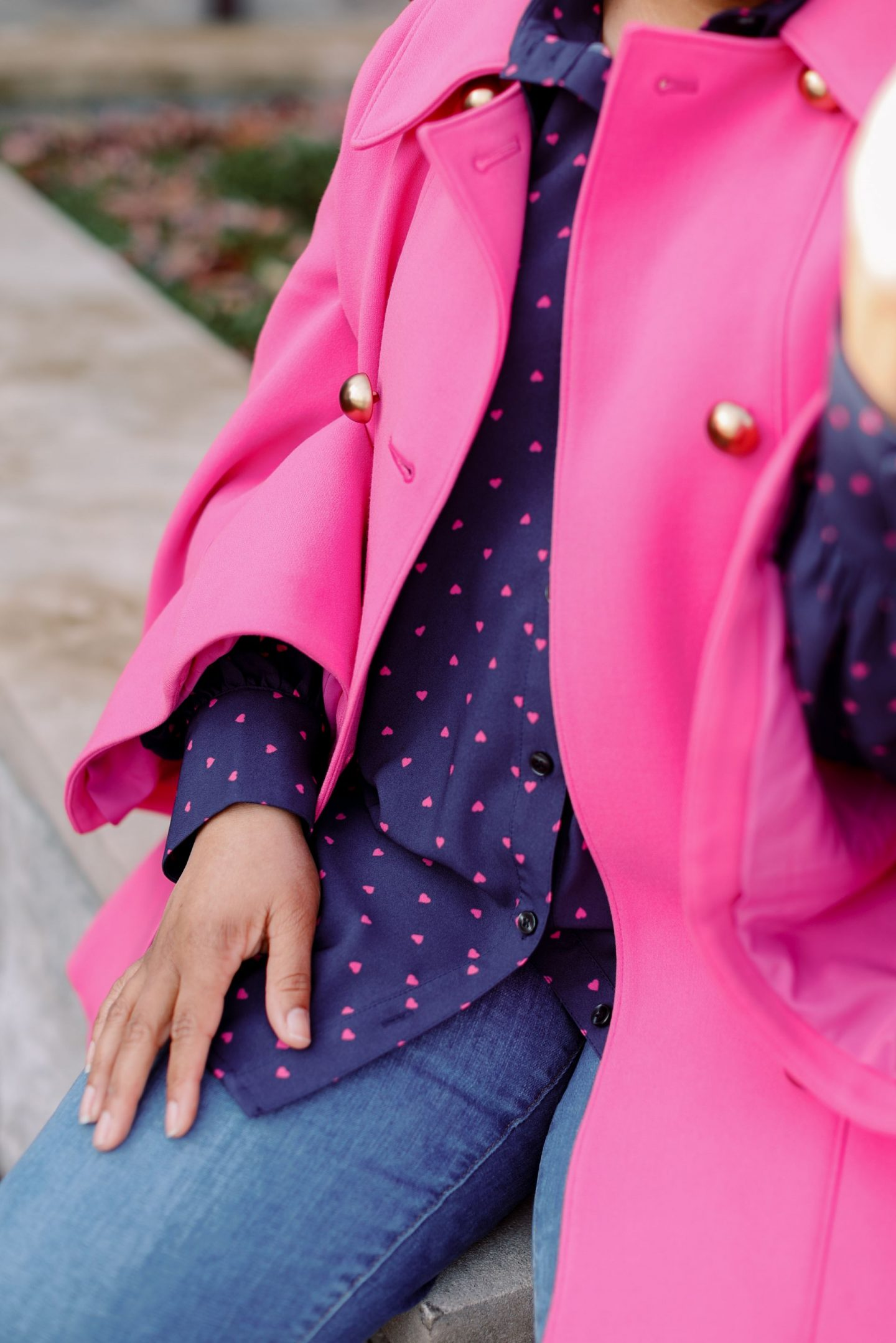 Pink Clothing by popular Kentucky fashion blog, Really Rynetta: image of a woman wearing a pink cape, jeans, and pink bow point toe heels.