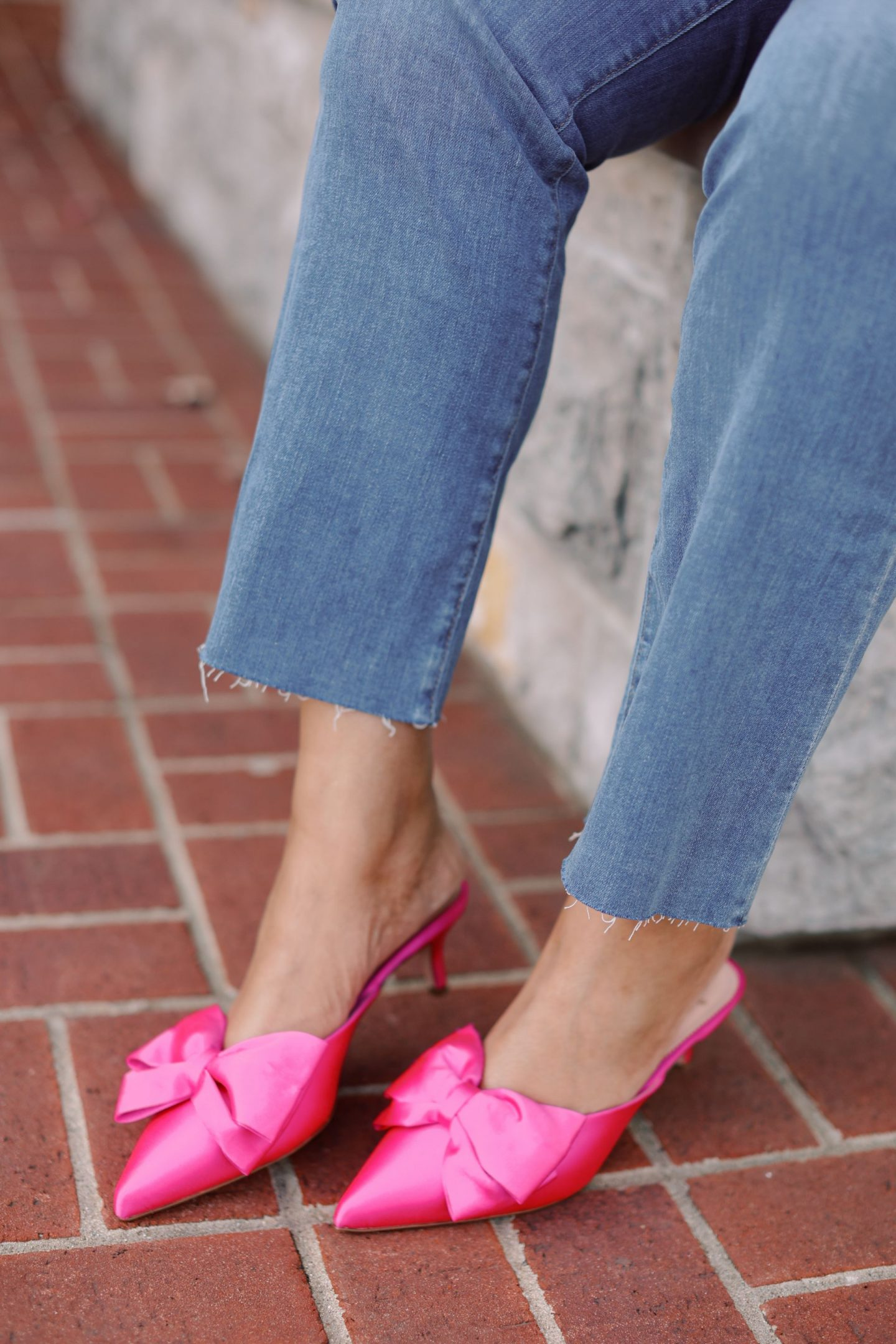 Pink Clothing by popular Kentucky fashion blog, Really Rynetta: image of a woman wearing jeans and pink bow point toe heels.