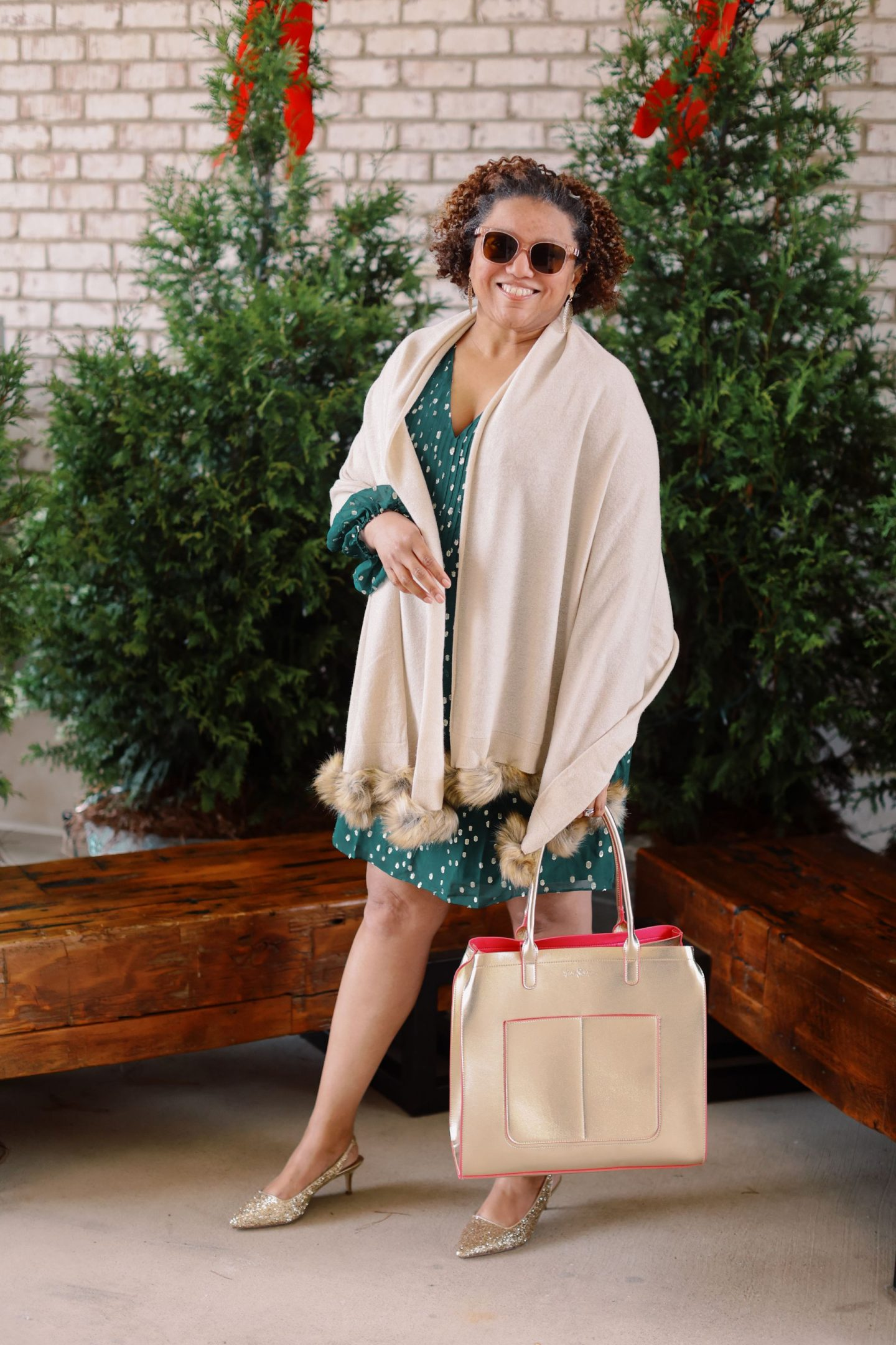 Friday Faves by popular Kentucky fashion blog, Really Rynetta: image of a woman standing in front of some pine trees and wearing a Lilly Pulitzer Cleme Silk Dress, Lilly Pulitzer Shaina Slingback Glitter Heel, wrap with fur pom poms, Lilly Pulitzer Lilly Lace Statement Earrings, and holding a gold tote bag.
