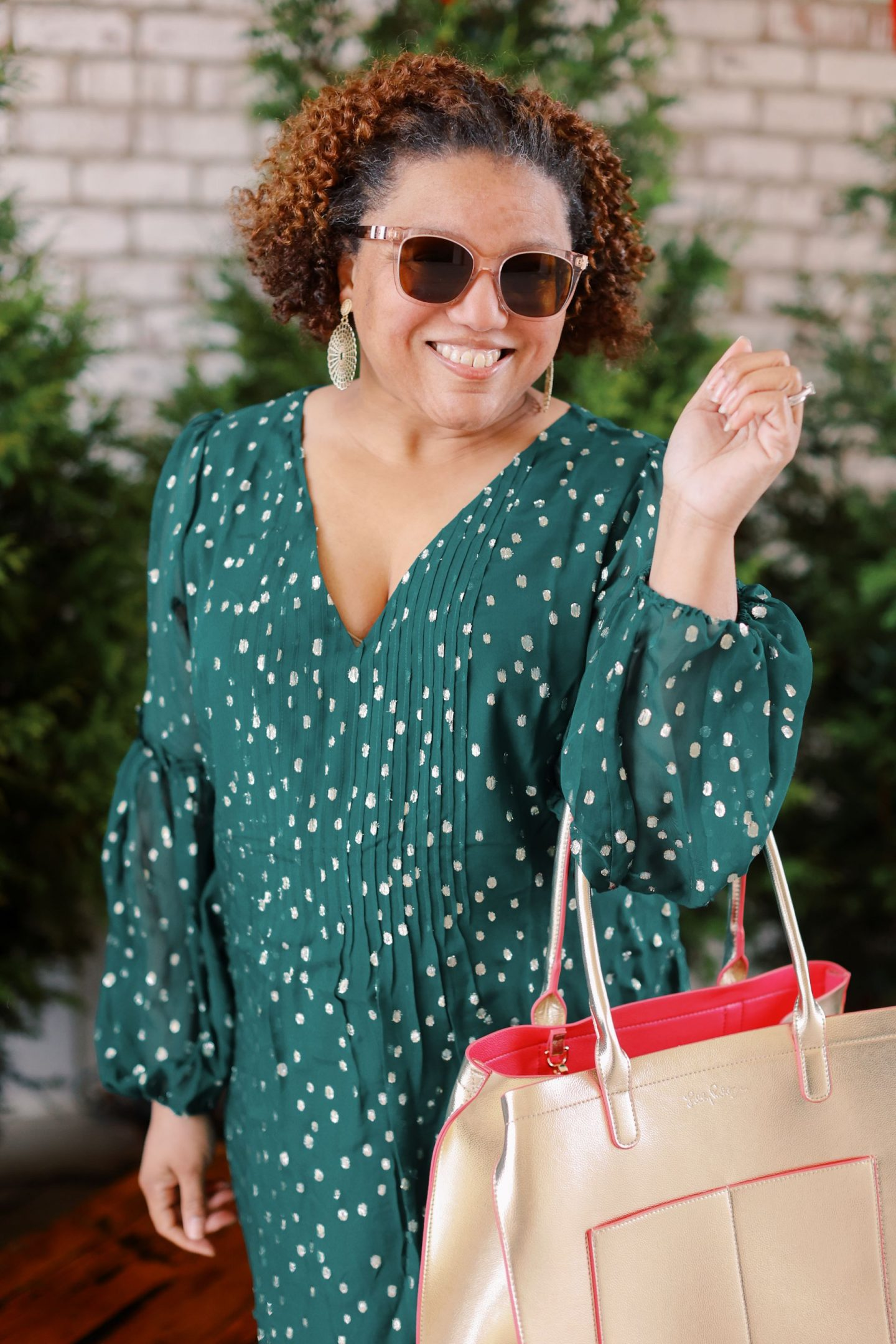 Lilly Pulitzer Sale by popular Kentucky fashion blog, Really Rynetta: image of a woman wearing a Lilly pulitzer dress with gold glitter heels and holding a gold Lilly Pulitzer tote bag.