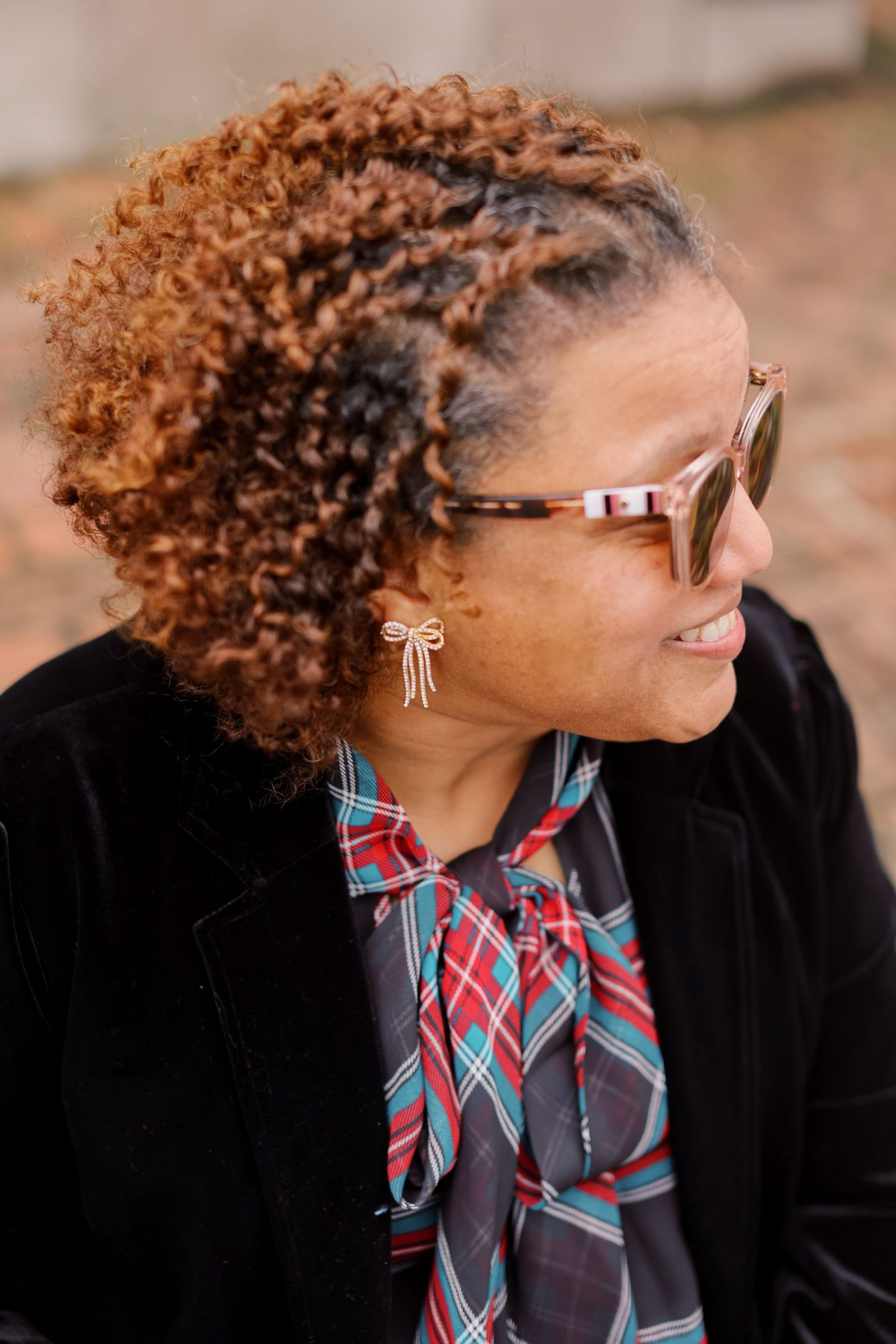 Holiday Outfits by popular Kentucky fashion blog, Really Rynetta: image of a woman standing outside and wearing a velvet suit and tartan plaid shirt.