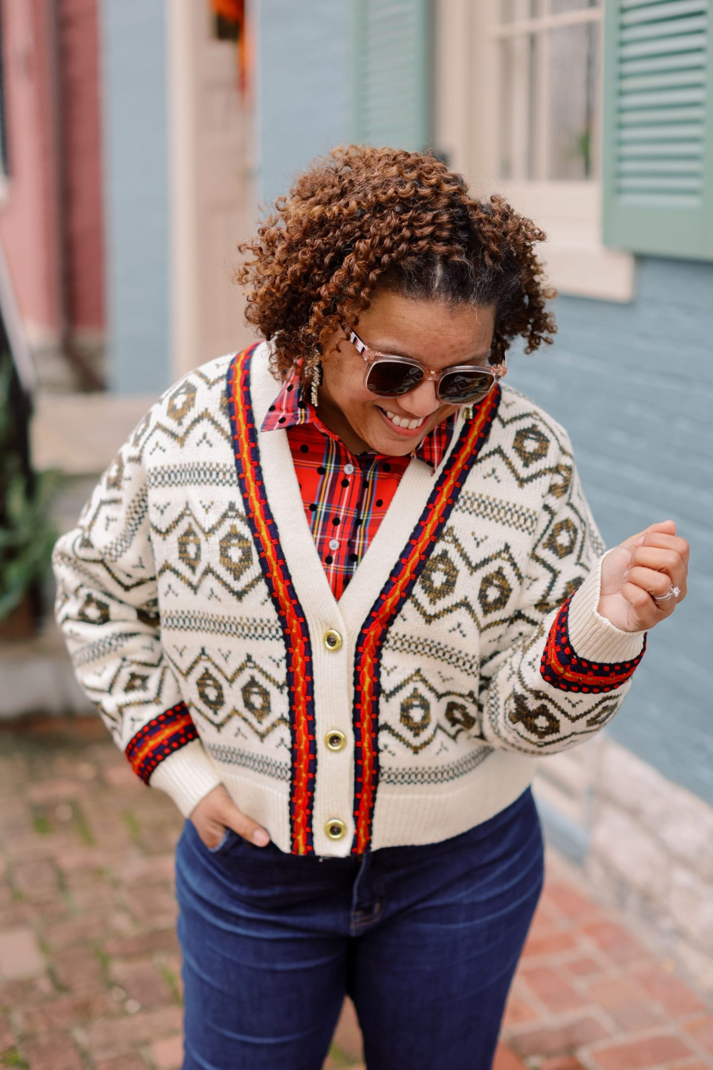 Holiday Outfits by popular Kentucky fashion blog, Really Rynetta: image of a woman standing outside and wearing a red plaid button up, alpine sweater and jeans.