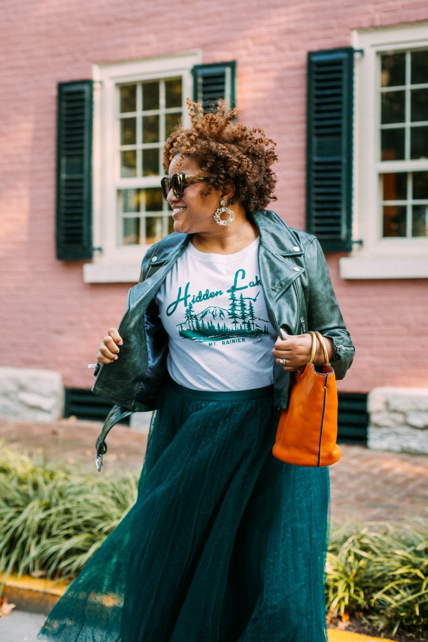 Leather Jackets by popular Kentucky fashion blog, Really Rynetta: image of a woman wearing a black leather jacket with a black tulle maxi skirt and white graphic t-shirt.
