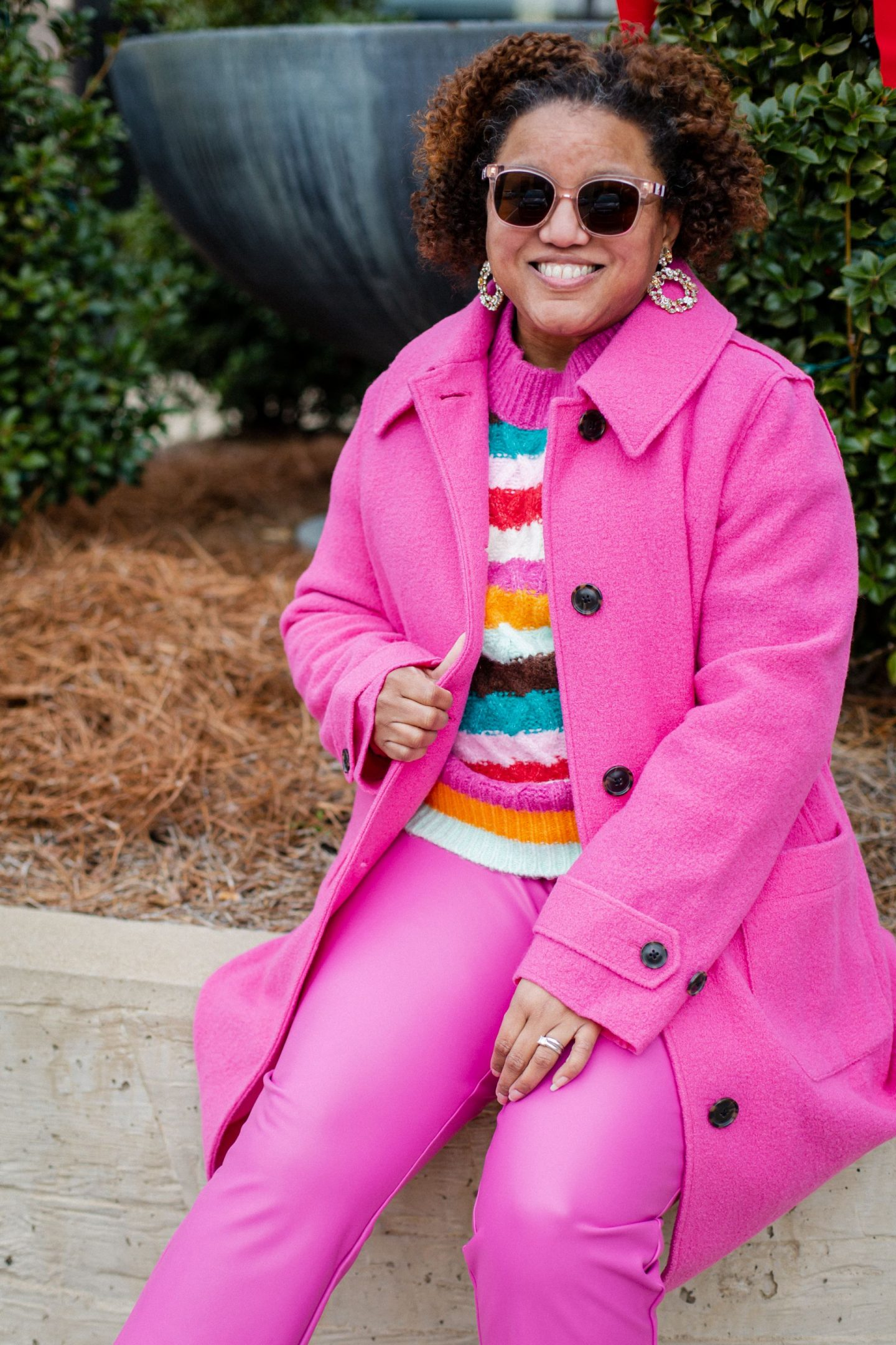 Pink Clothing by popular Kentucky fashion blog, Really Rynetta: image of a woman wearing a multi color stripe sweater with pink pants, and pink wool coat.