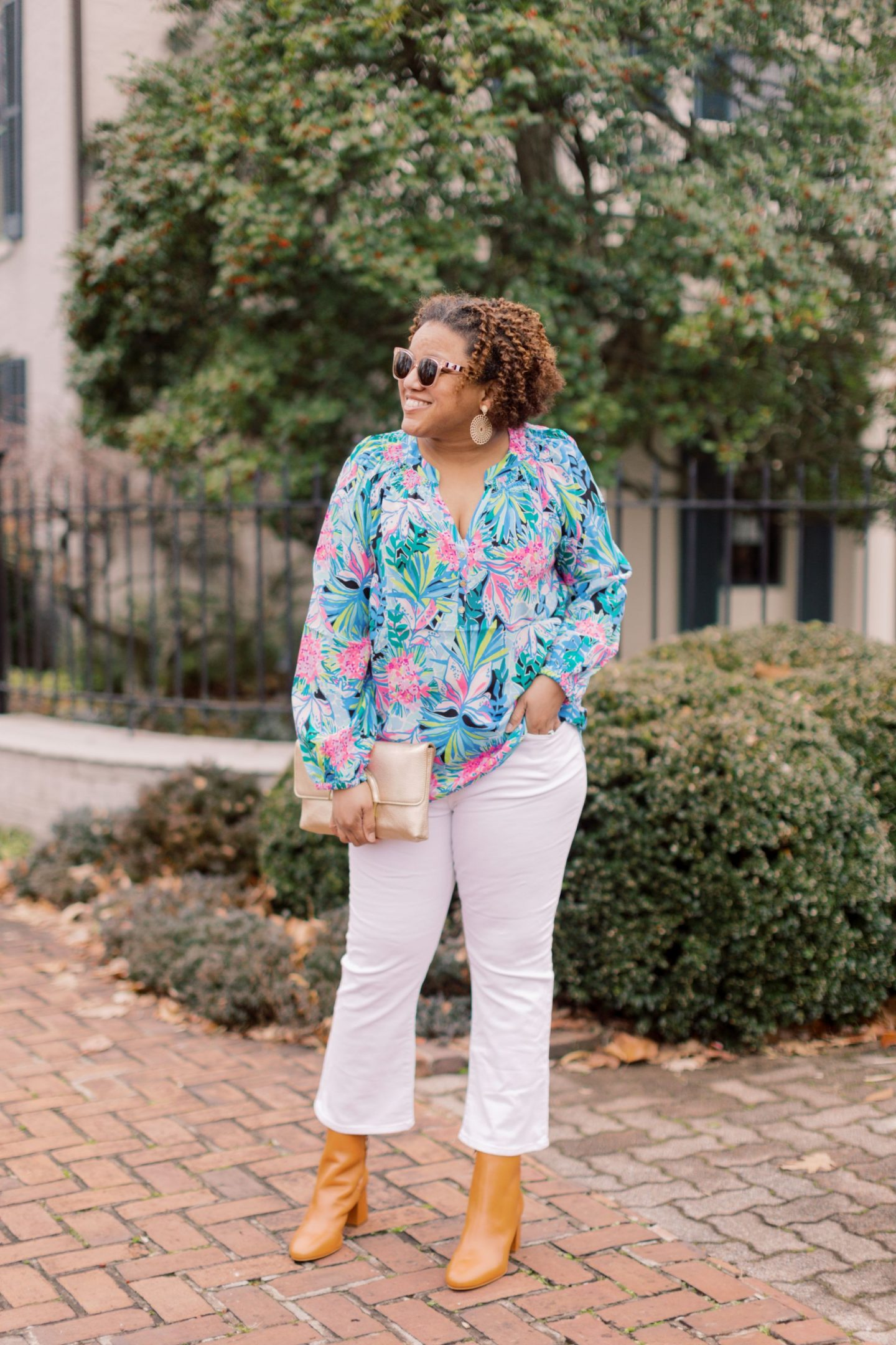 Lilly Pulitzer Sale by popular Kentucky fashion blog, Really Rynetta: image of a woman wearing a Lilly Pulitzer Elsa Silk top with white jeans and tan ankle boots.