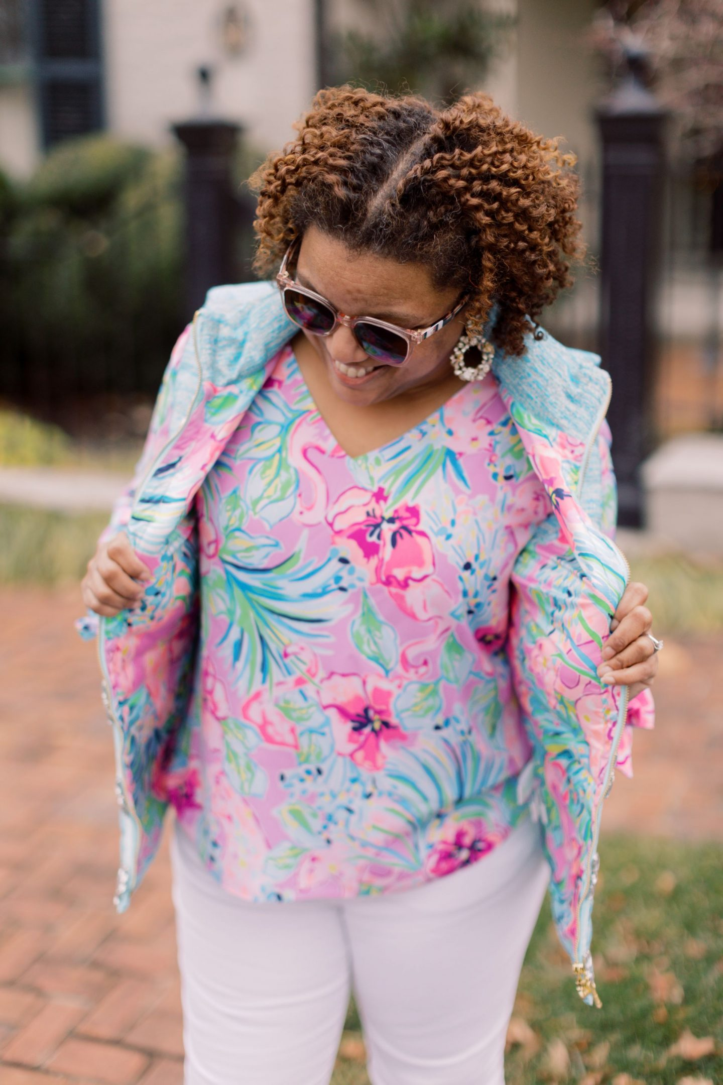 Lilly Pulitzer Sale by popular Kentucky fashion blog, Really Rynetta: image of a woman wearing a Lilly Pulitzer puffer vest and Pamela top.