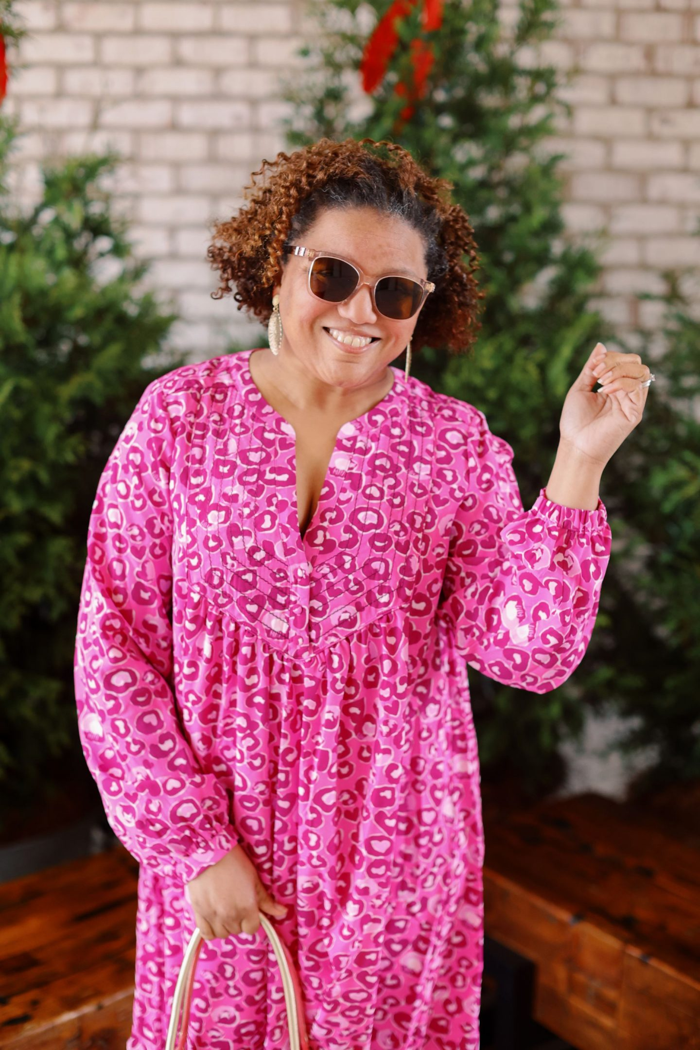 Lilly Pulitzer New Arrivals by popular Kentucky fashion blog, Really Rynetta: image of a woman wearing a pink leopard print Lilly Pulitzer dress.