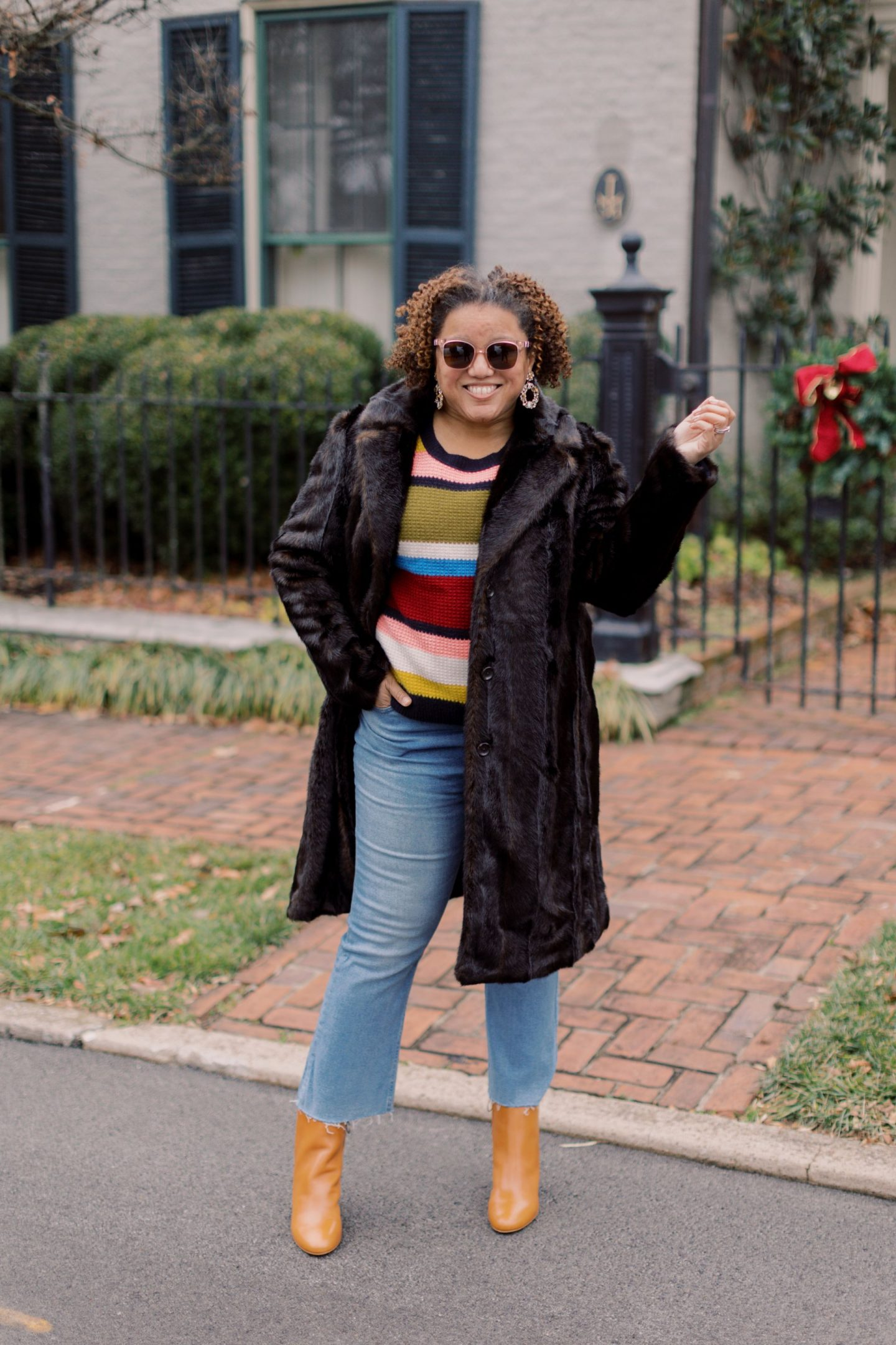 Colorful Sweaters by popular Kentucky fashion blog, Really Rynetta: image of a woman standing outside and wearing a J. Crew Cashmere Waffle-Knit Sweater in Stripe, cropped denim, J. Crew Cocoon Coat in Italian Stadium-Cloth Wool, brown leather ankle boots, and holding a brown leather tote.