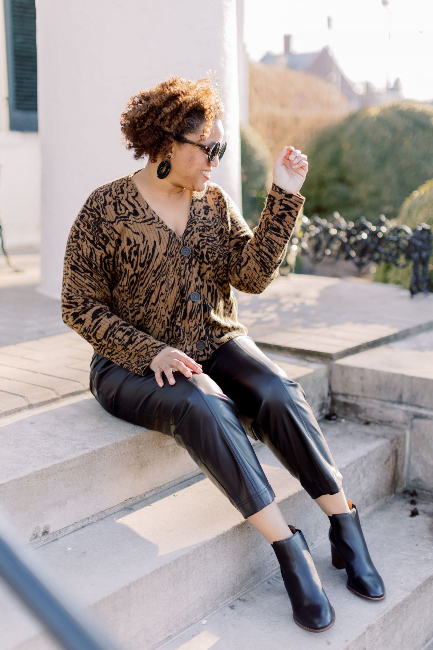 Faux Leather by popular Kentucky fashion blog, Really Rynetta: image of a woman wearing a cropped leopard sweater and faux leather pants with black ankle boots.