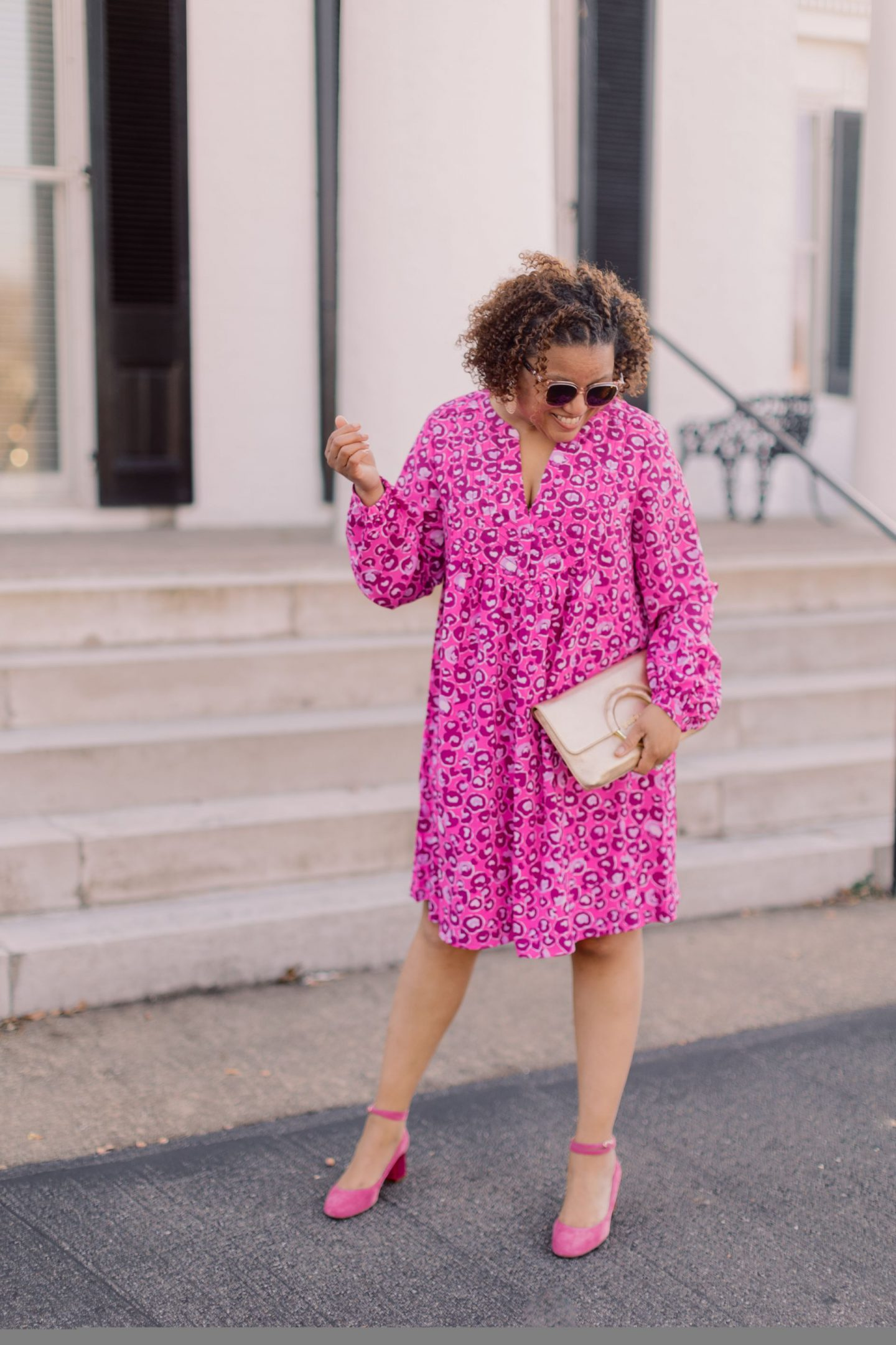 Valentine's Day Looks by popular Kentucky fashion blog, Really Rynetta: image of a woman wearing a pink leopard print dress with pink suede ankle strap heels and holding a rose gold clutch and wearing rose gold statement earrings.