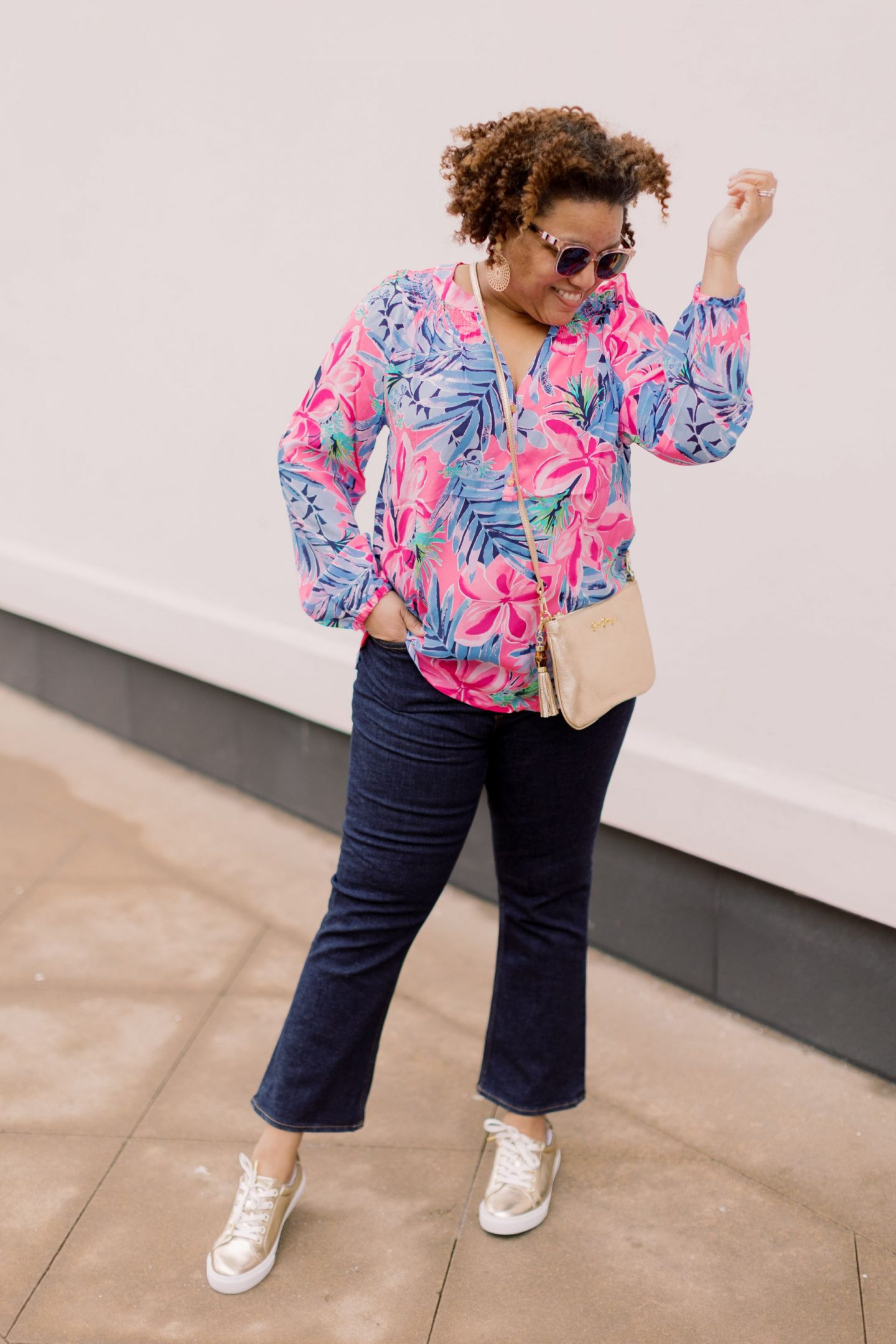 Lilly Pulitzer New Arrivals by popular Kentucky fashion blog, Really Rynetta: image of a woman wearing a Lilly Pulitzer Elsa silk top, flare jeans, and Lilly Pulitzer Hallie lux sneaker.
