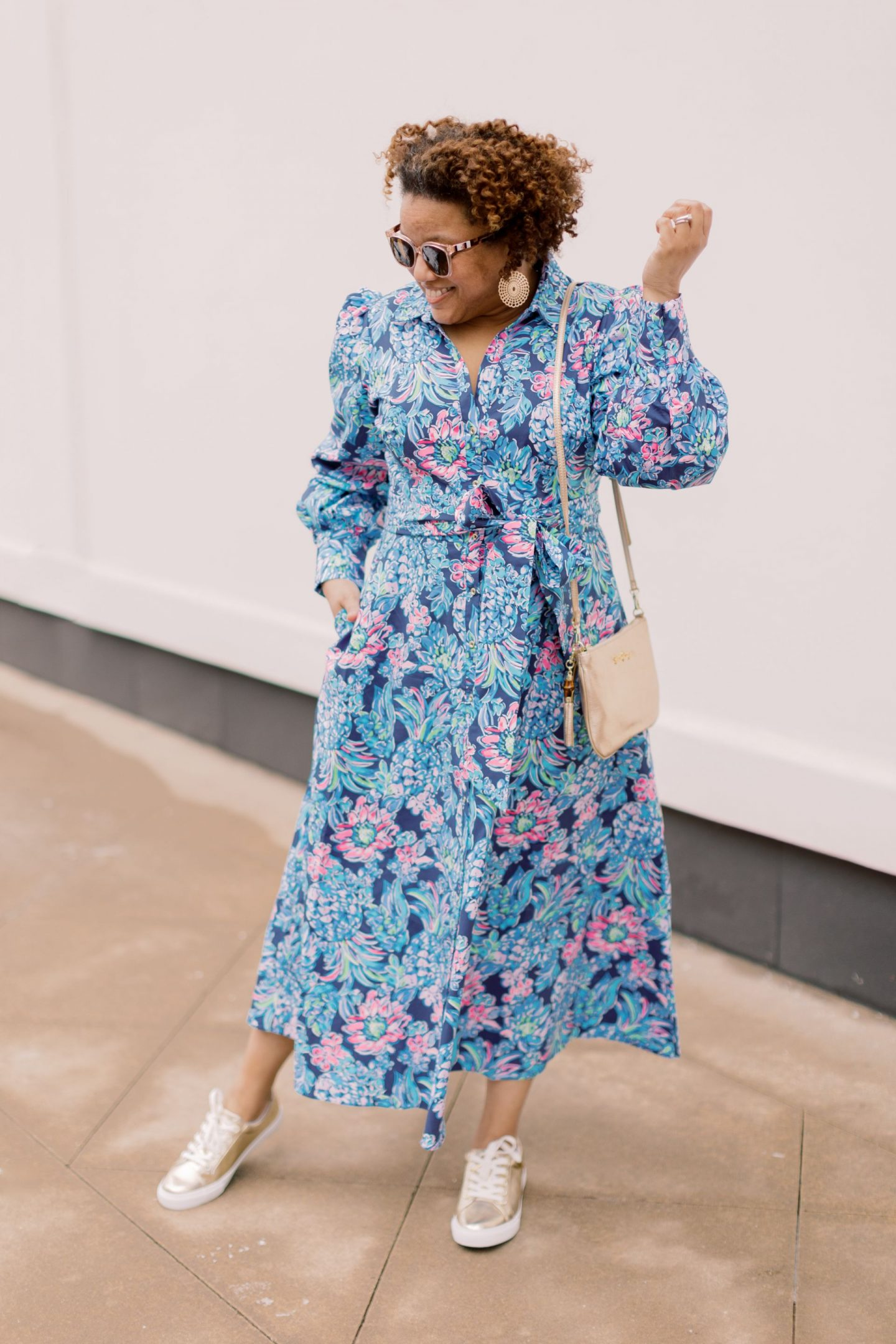 Lilly Pulitzer New Arrivals by popular Kentucky fashion blog, Really Rynetta: image of a woman wearing a Lilly Pulitzer Mira Stretch Midi Shirtdress and Lilly Pulitzer Hallie lux sneaker.