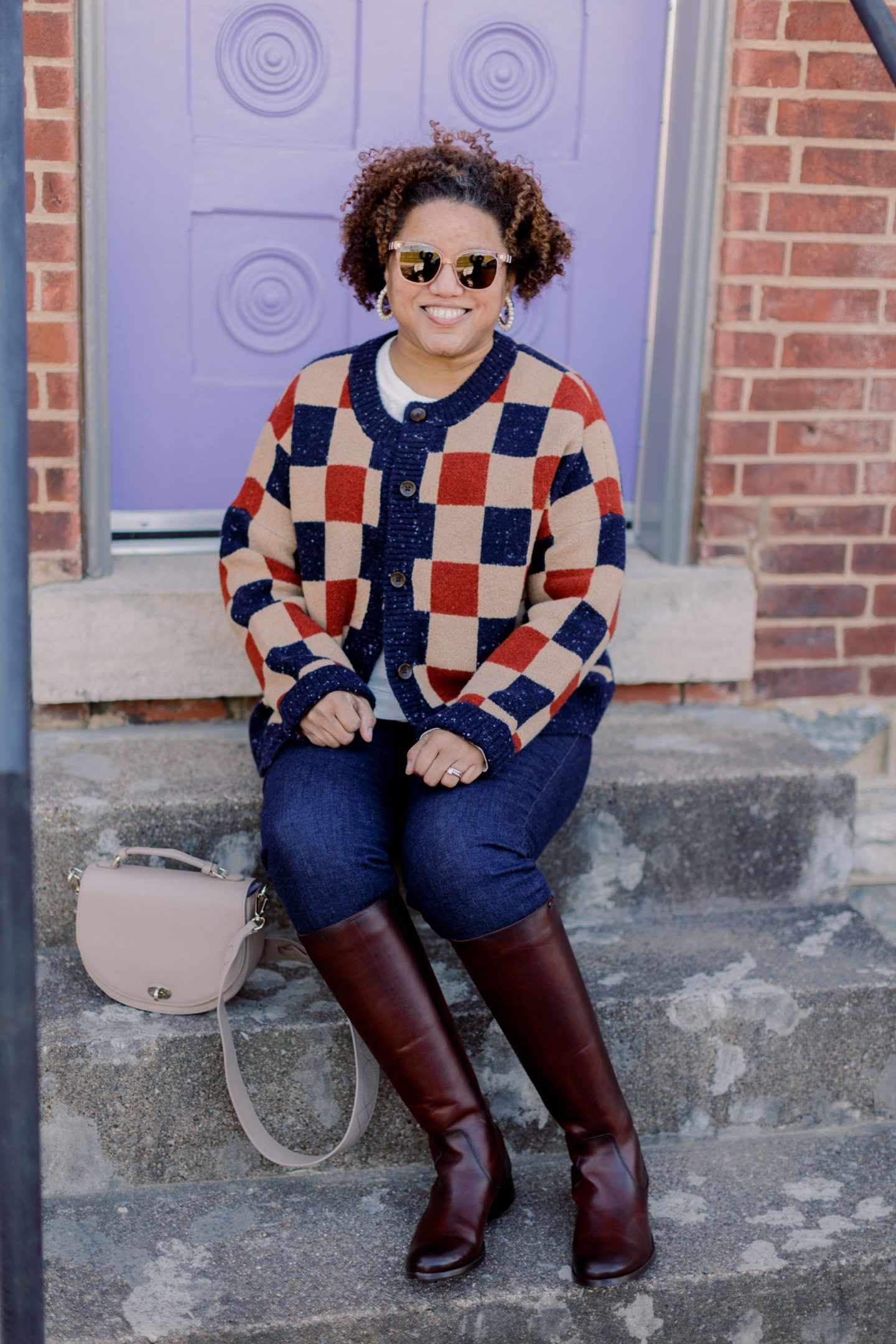 Winter Sweaters by popular Kentucky fashion blog, Really Rynetta: image of a woman wearing a Madewell checkered cardigan sweater, jeans, and brown knee high boots.