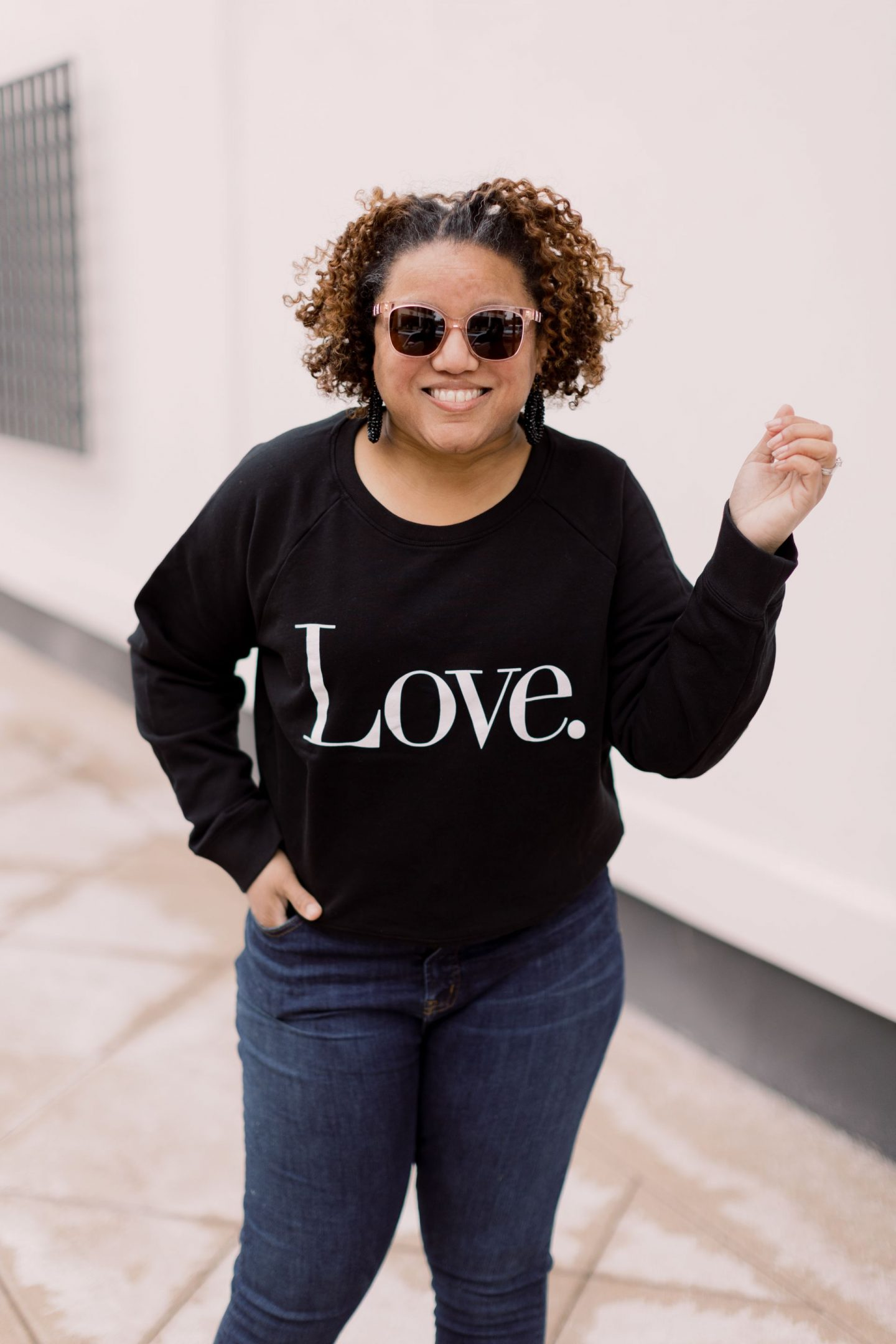 Valentine's Day Looks by popular Kentucky fashion blog, Really Rynetta: image of a woman wearing a black love sweatshirt, skinny jeans, and black ankle boots.