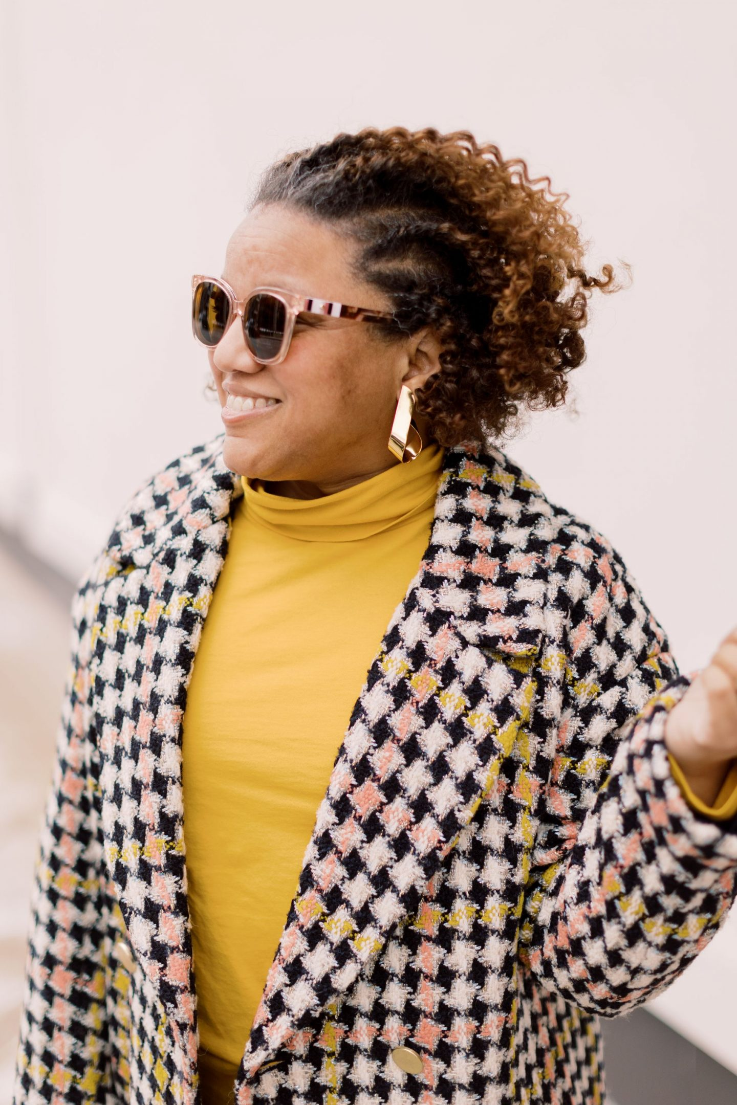 Cute Coats by popular Kentucky fashion blog, Really Rynetta: image of a woman wearing a J. Crew Tissue Turtleneck, gold statement earrings, sunglasses, and a black, white, pink and yellow houndstooth coat.