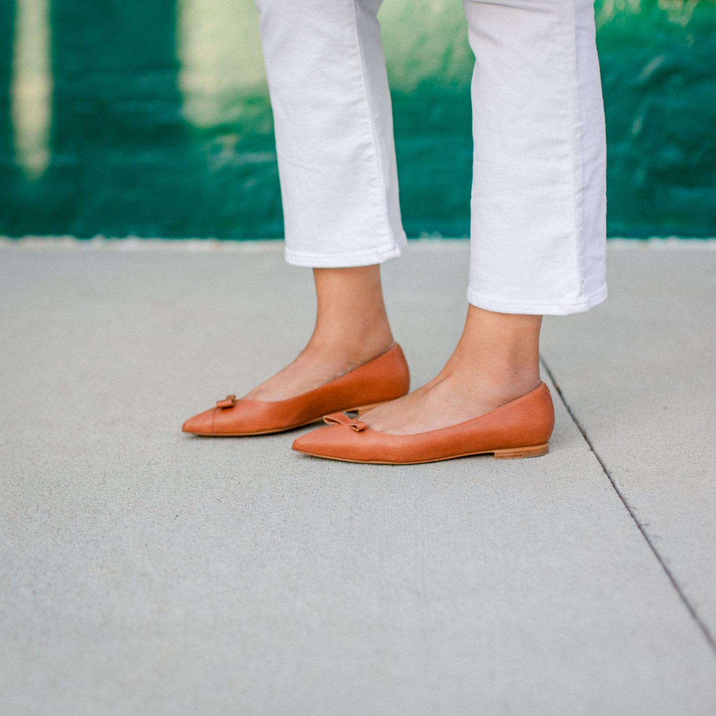 Sarah Flint Shoes by popular Kentucky fashion blog, Really Rynetta: image of a woman wearing a white t-shirt, white flare crop jeans, rainbow plaid coat, and Sarah Flint brown point toe falts.